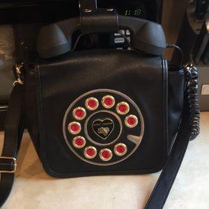 Betsey Johnson phone purse.